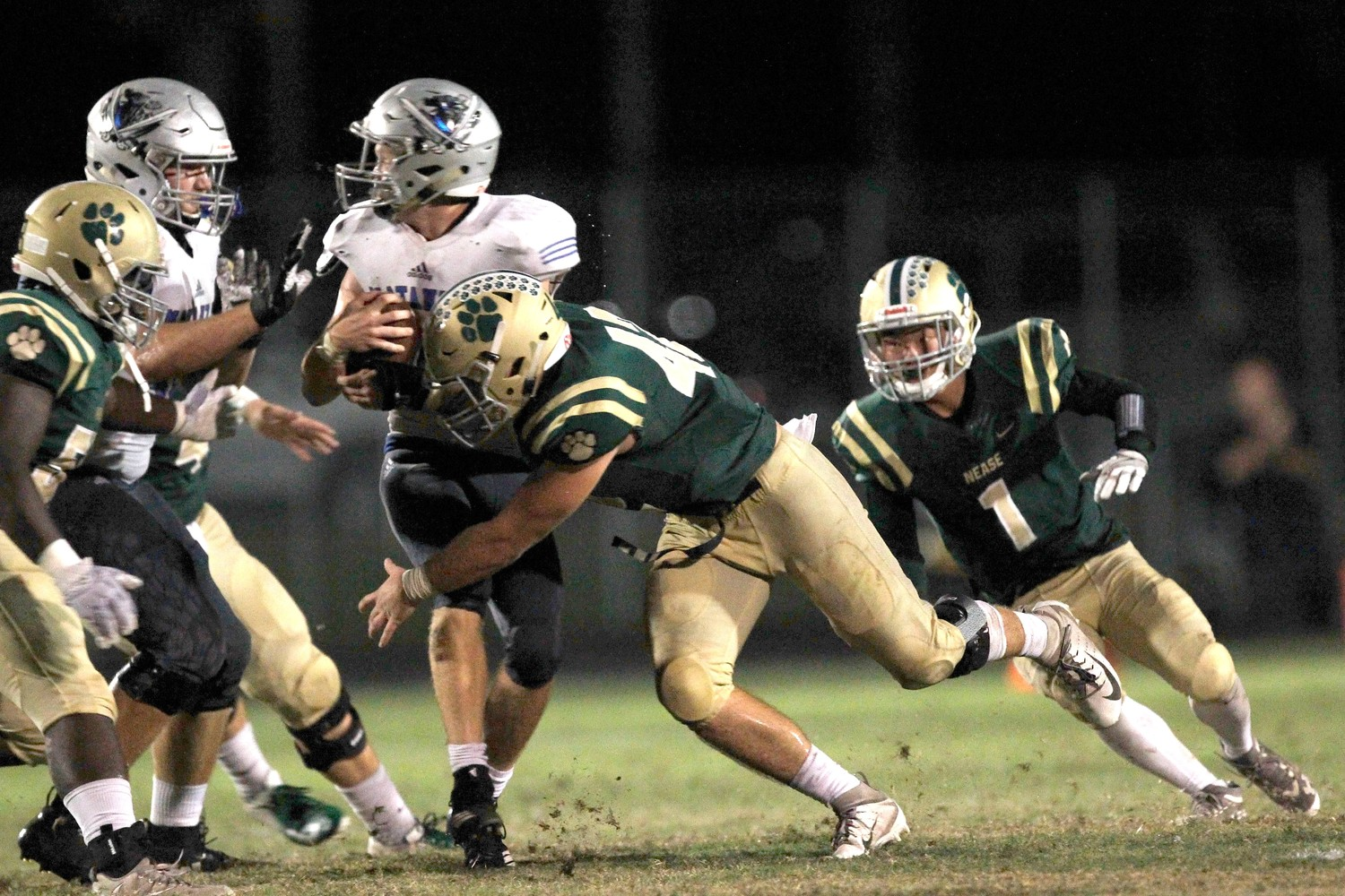 Nease defenders enshroud the Matanzas ball carrier.