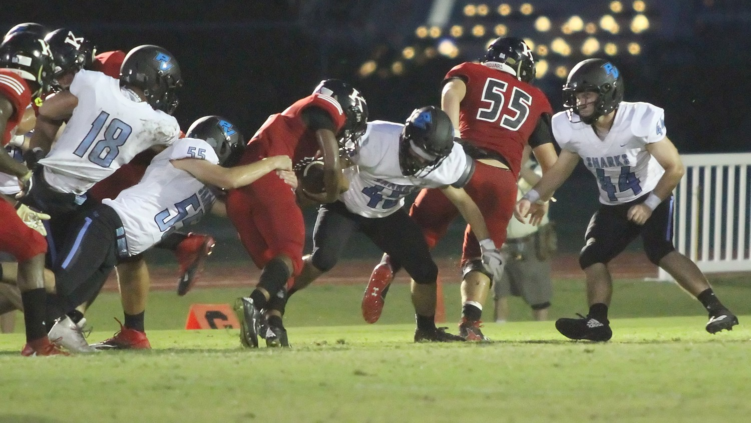 Will Frank (55) and Garrett Griffin (45) bring down the Crusaders' ball carrier in Ponte Vedra's 16-13 win over Bishop Kenny on Sept. 28.