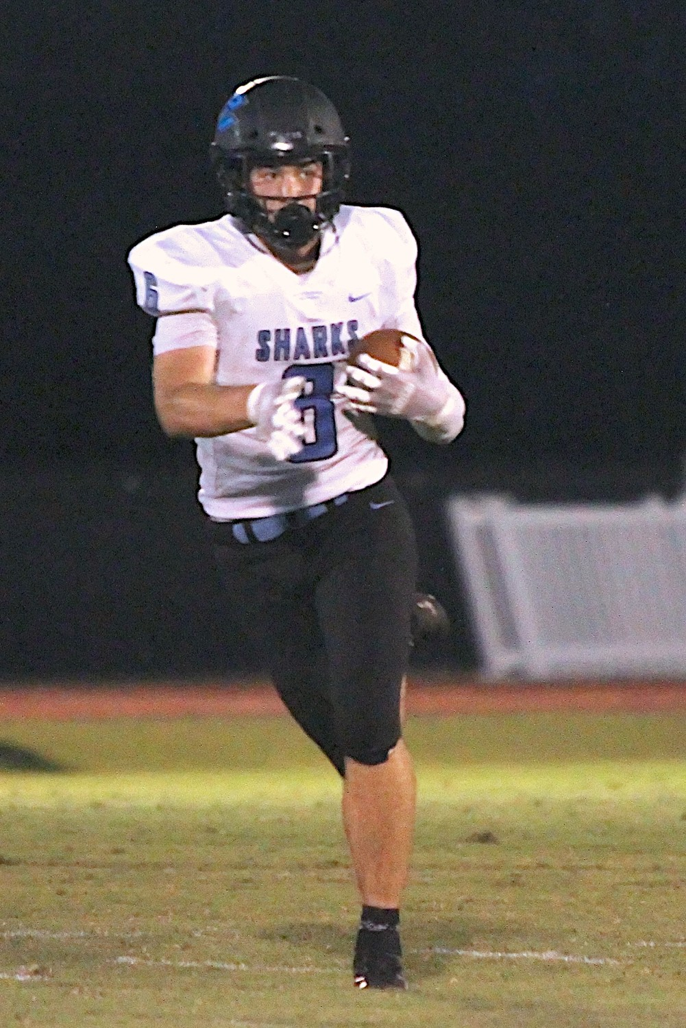 Nick Pirris (6) pulls down a pass for the Sharks.