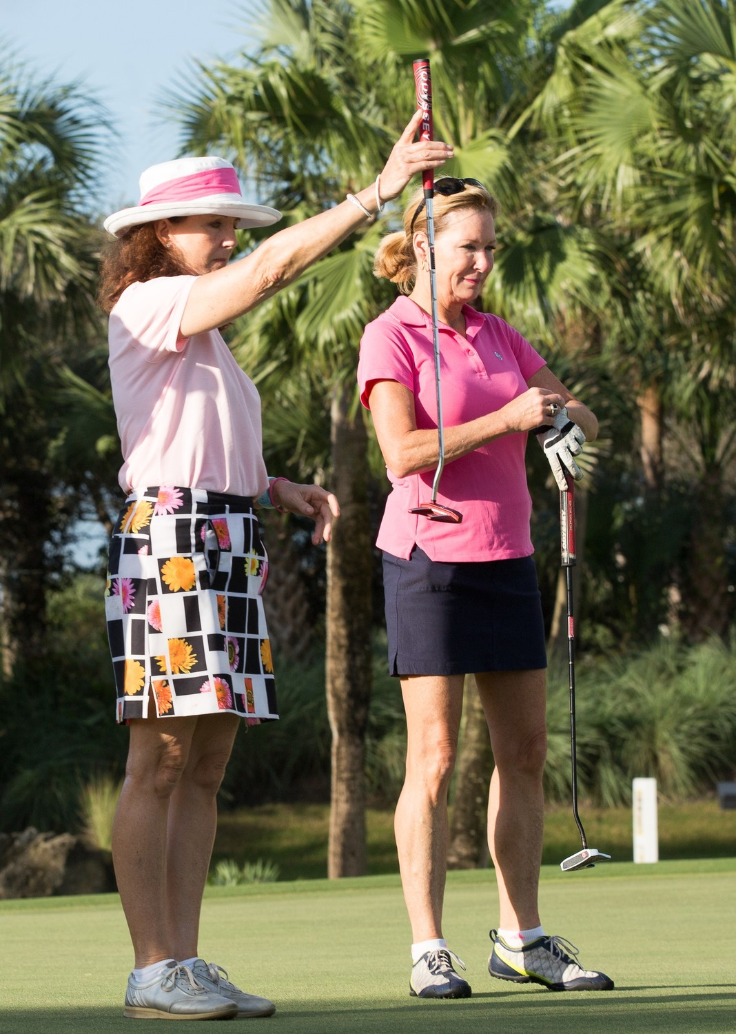 Cynthia Hastings and Carol Ditzel play in the Pink Ribbon Golf Classic.