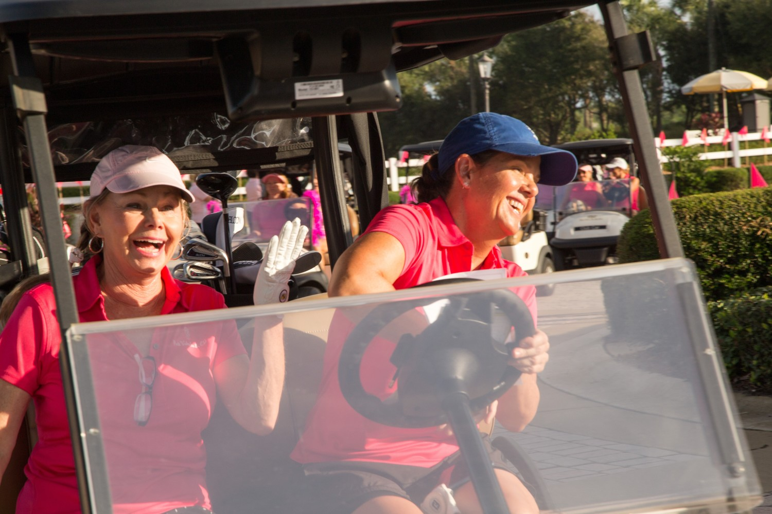 Pink Ribbon golfers have some fun while driving their golf carts.