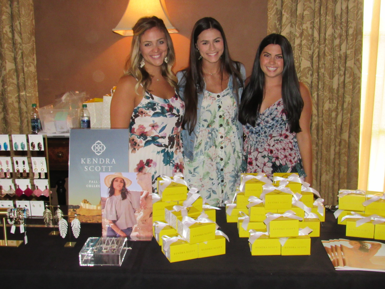 Lexi Lahiff, Morgan Slaughter and Brittany Fowler sell Kendra Scott products at the event to benefit Nemours.