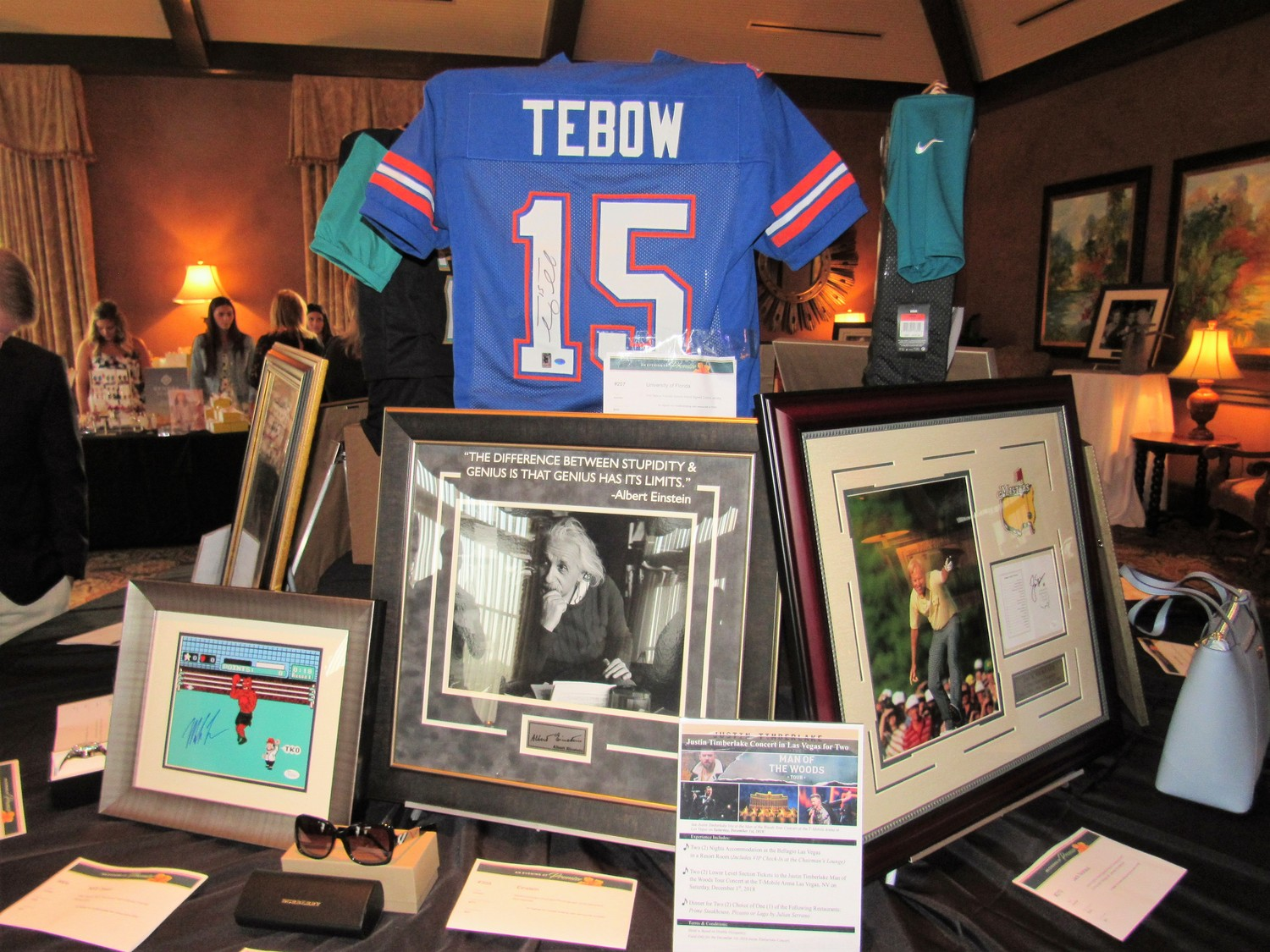 Autographed items are auctioned off to benefit Nemours Children's Specialty Care in Jacksonville, including a Tim Tebow football jersey.