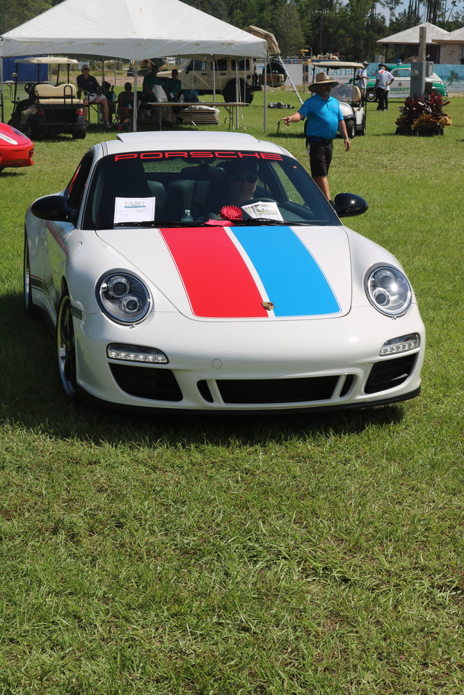"Charles Cordes drives in his 2012 Porsche B59, which was awarded the Porsche Jacksonville ""For the Spirit of It!"" award, sponsored by Porsche of Jacksonville."