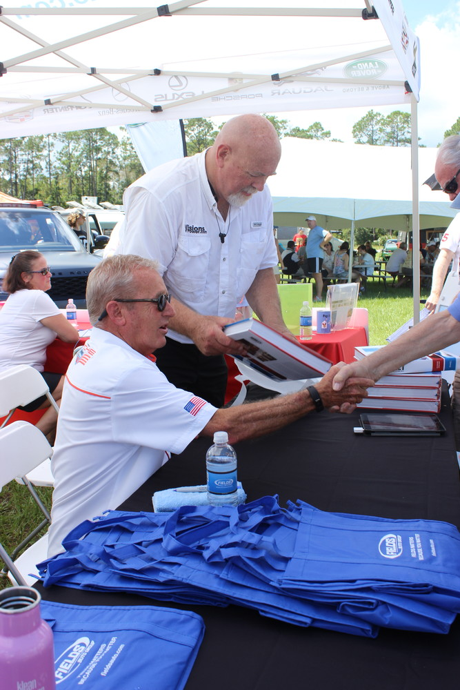 "Racing legend Hurley Haywood signs copies of his new book, ""Hurley: From the Beginning."""