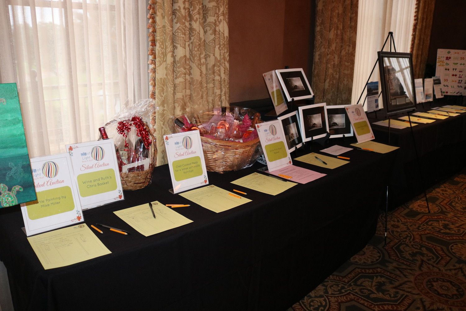 Silent auction items are on display at the BEAM of Light Ball.