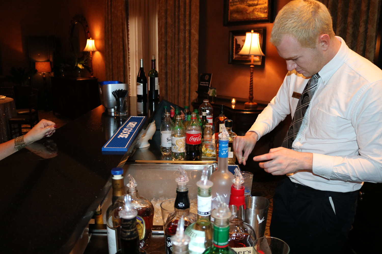 A bartender prepares a drink at the BEAM of Light Ball.