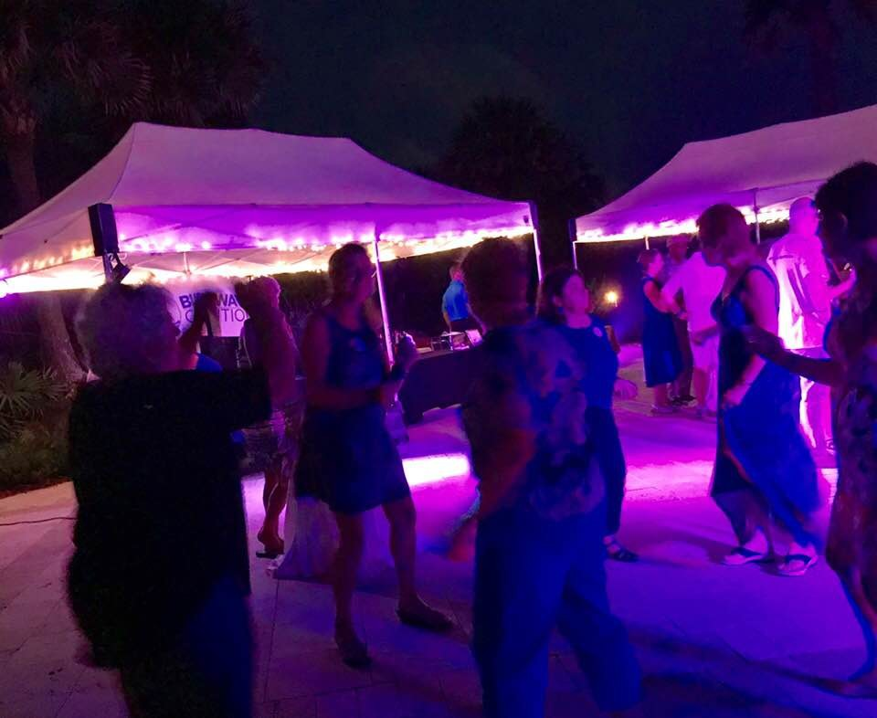 Blue Wavers dancing the night away during at the Blue Wave Coalition Beach Bash on Aug. 25.