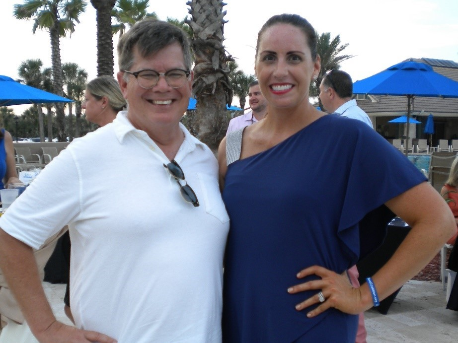 Blue Wavers Dave Rogers (left) and Erica Connor, who were unopposed for seats on the Soil and Water Commission, celebrate at the Beach Bash