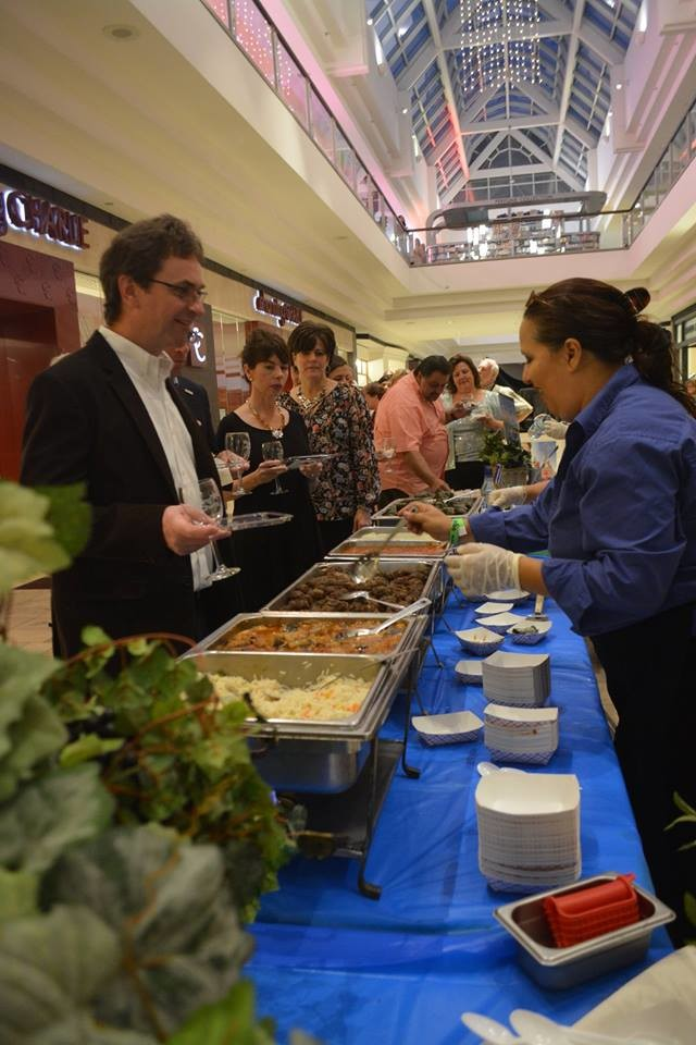 Attendees of last year's Caring Chefs enjoy sampling the various foods offered at the event.