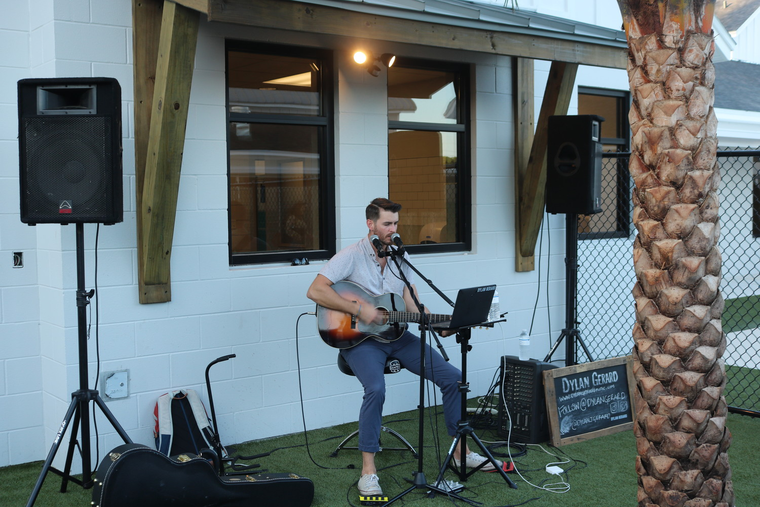 Dylan Gerard performs live music at the Pet Paradise Bartram VIP event.