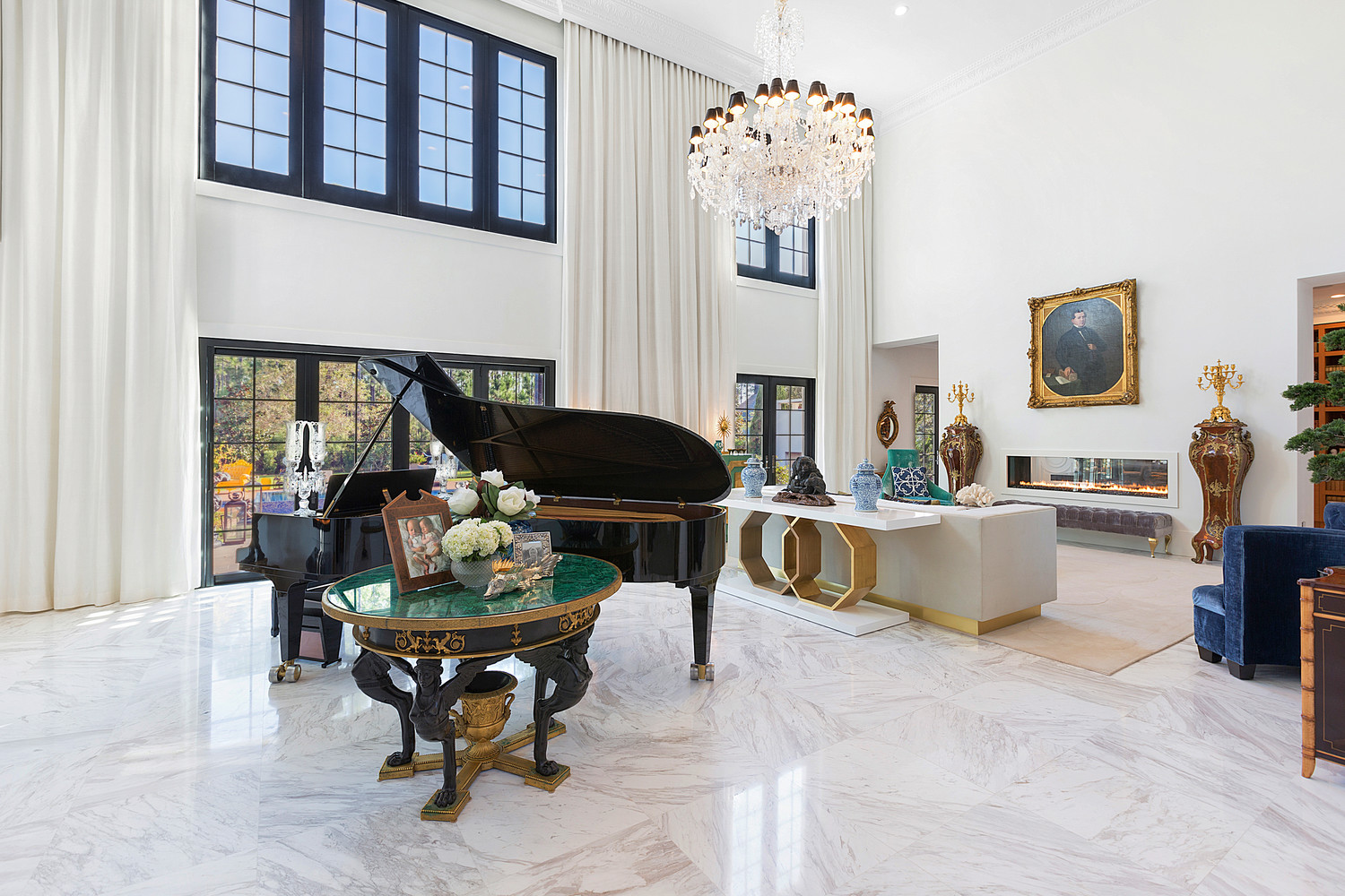 This room features a grand piano that was built for Julie Andrews and a Russian Empire malachite table with a dore and ebonized bronze base, among several other attractions.