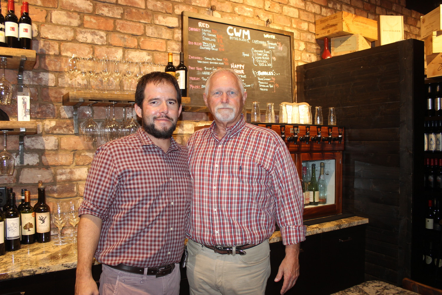 Coastal Wine Market & Tasting Room Co-owner Steve Lourie and employee Allen Horne