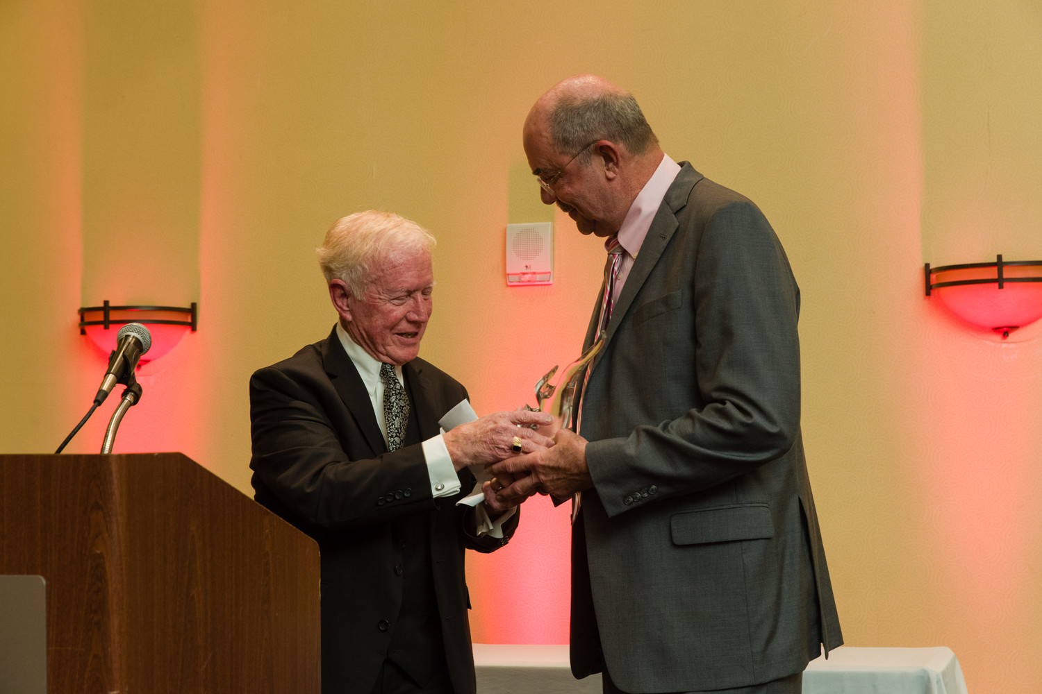 Dr. Stanton Longenecker (right) receives the Distinguished George S. Trotter Founders Award from Dr. George Trotter at the We Care Jacksonville Caring Awards Gala on Aug. 25.