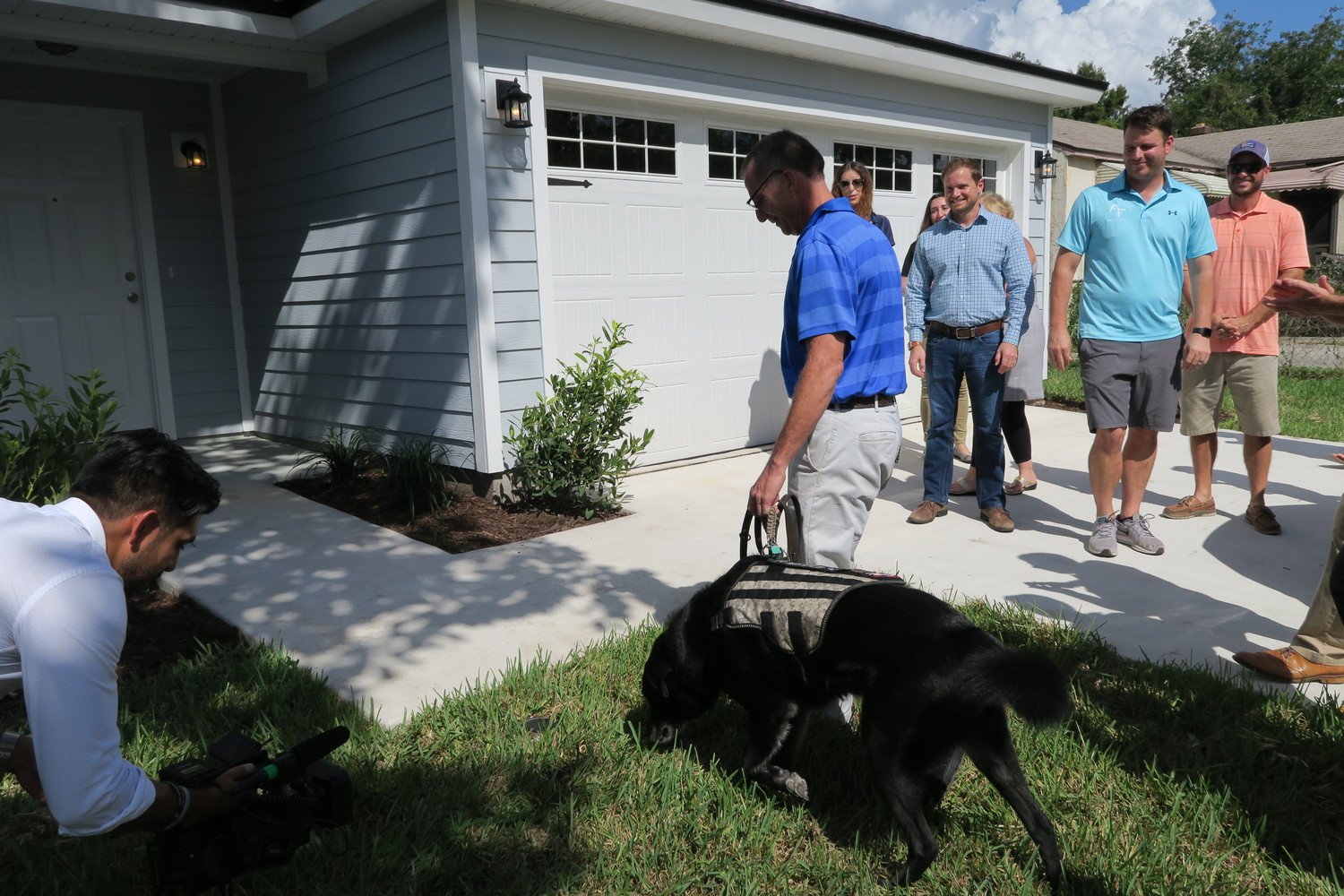Army veteran Rick Smith and hist service dog Berkley walk into their new home for the first time.