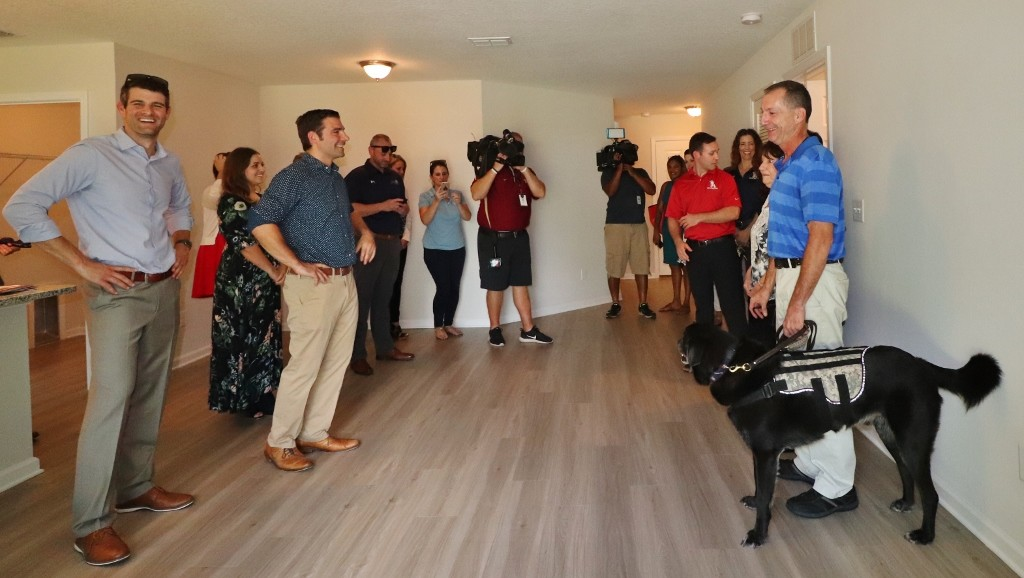 Home recipient Smith and the staff of JWB and K9s For Warriors tour the new home that was presented to Smith by JWB during a ceremony Oct. 17.
