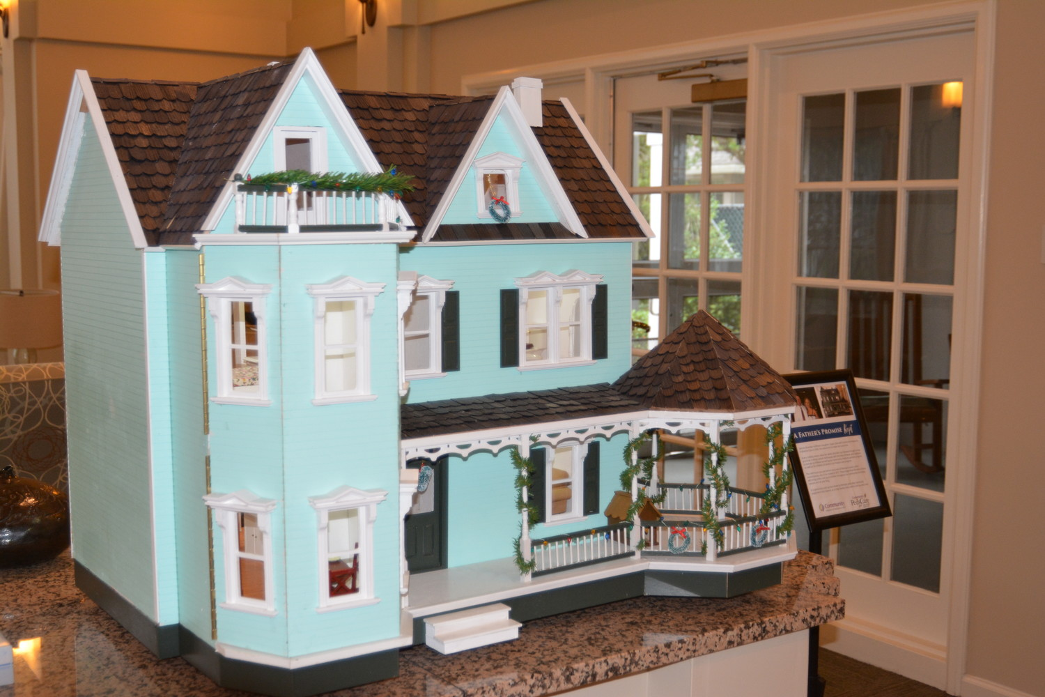 One of Hoffman's doll houses is displayed alongside his story in the lobby of Community Hospice & Palliative Care's Earl B. Hadlow Center for Caring in Jacksonville.