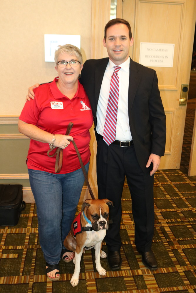 K9s For Warriors CEO Rory Diamond (right) raises support for wounded warriors at the event with Mary Daniel and Duke.