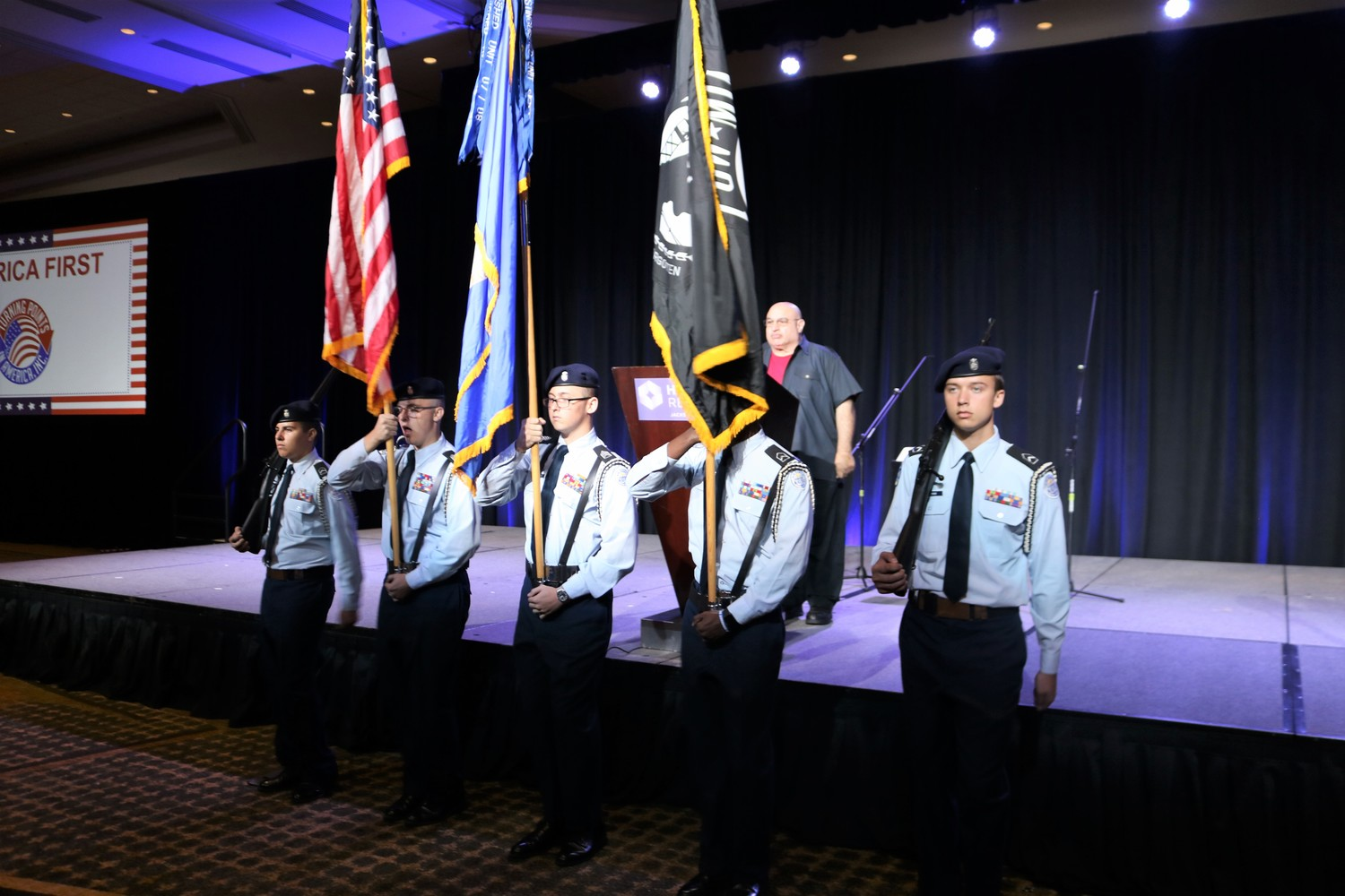 The Sandalwood High JROTC Color Guard presents the colors for the performance of the national anthem at a Benghazi tribute event in Jacksonville on Nov. 3.
