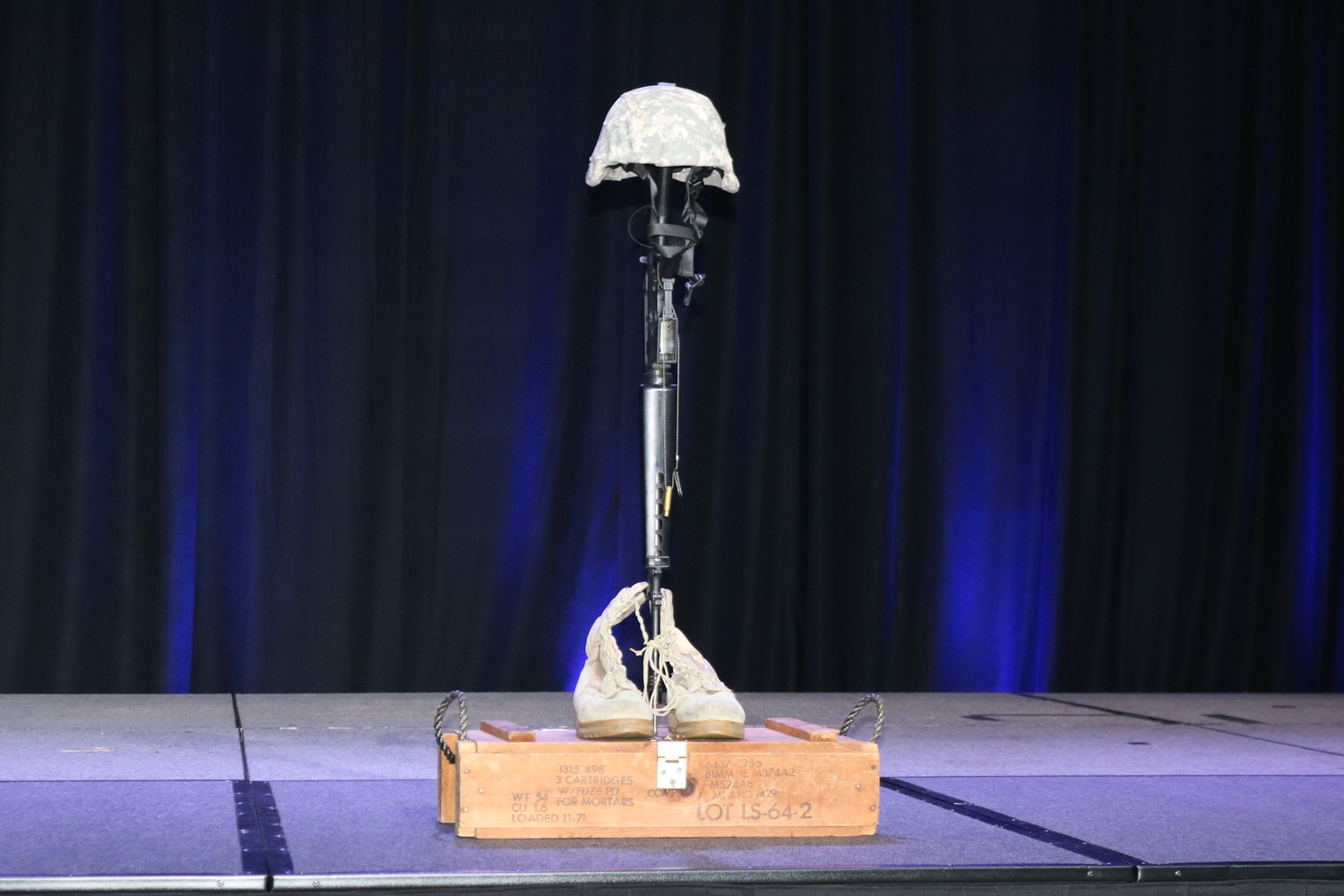 "A ""soldier's cross"" is displayed on stage in honor of America's fallen heroes."