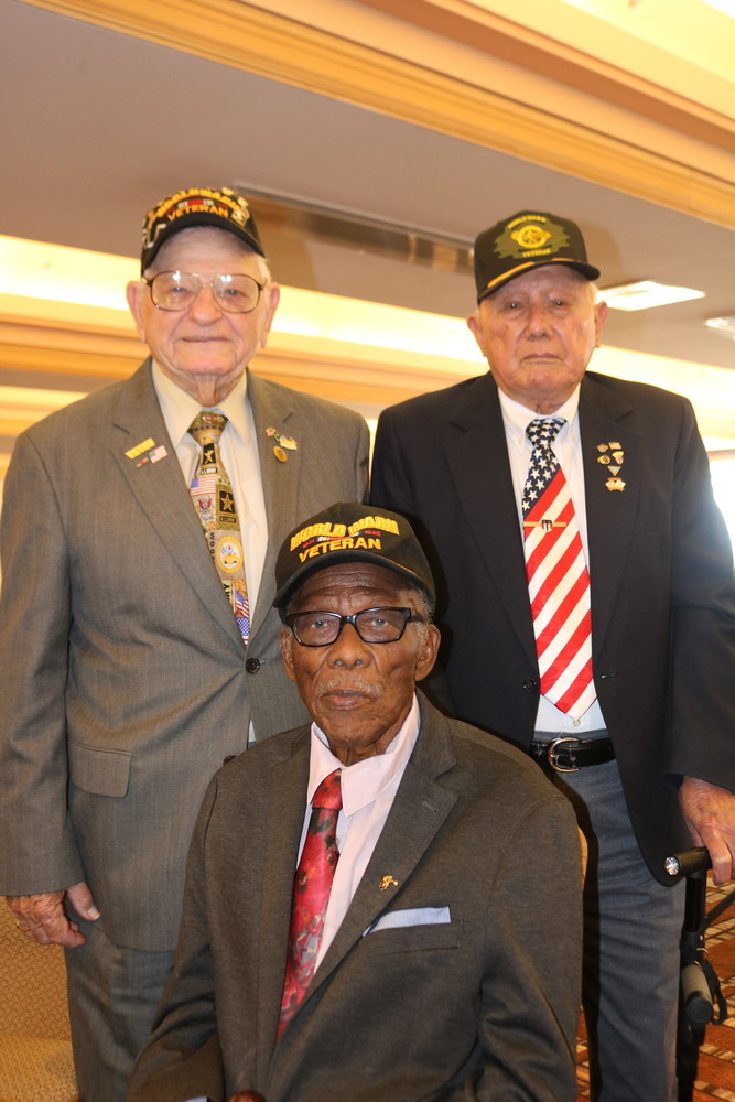 Veterans and honored guests (from top left) Robert W. Hall Sr., J.J. O'Brien and Sollie Mitchell gather at the VIP reception.