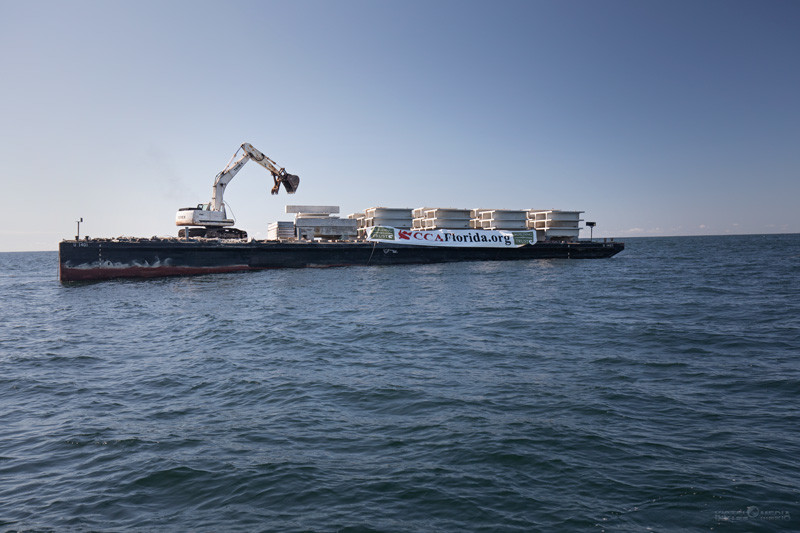 A ship deploys the concrete structures necessary to construct the Coastal Conservation Association / Building Conservation Trust Starship Reef Project.