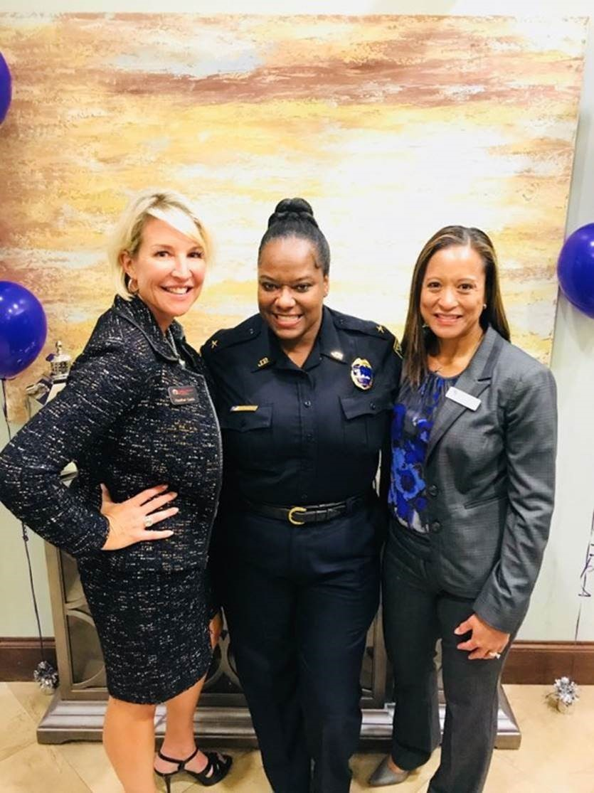 Florida Women's Law Group CEO Heather Quick, Jacksonville Sheriff's Office Assistant Chief Lakesha Burton and Hubbard House Board of Directors First Vice President Lisa McIntosh gather at an event on domestic violence hosted by Florida Women's Law Group on Oct. 23.