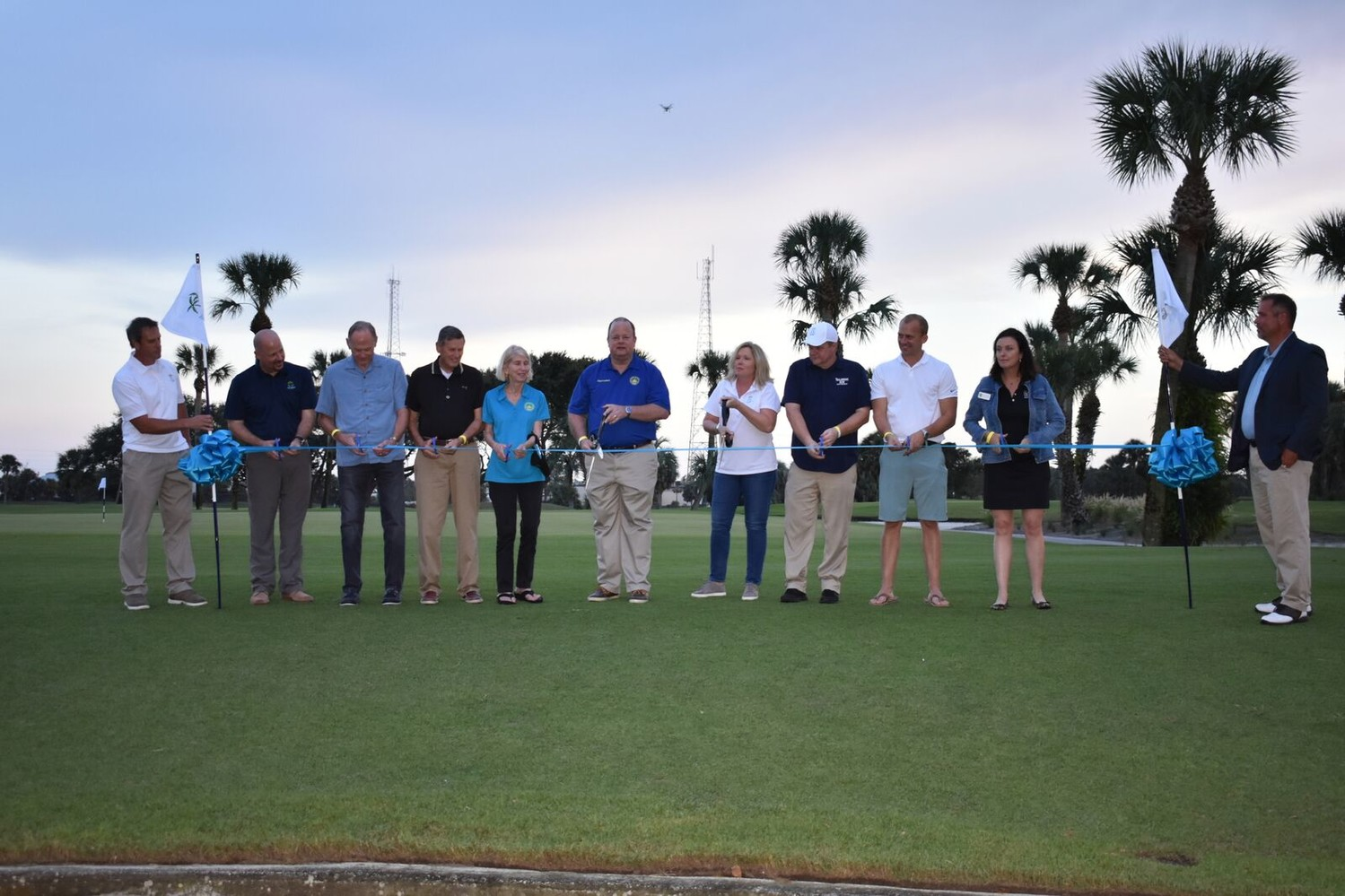 Local officials and Jax beach Golf Club leaders participate in a special ribbon-cutting ceremony on Friday, Nov. 9 to officially reopen the club after a $2 million renovation project.