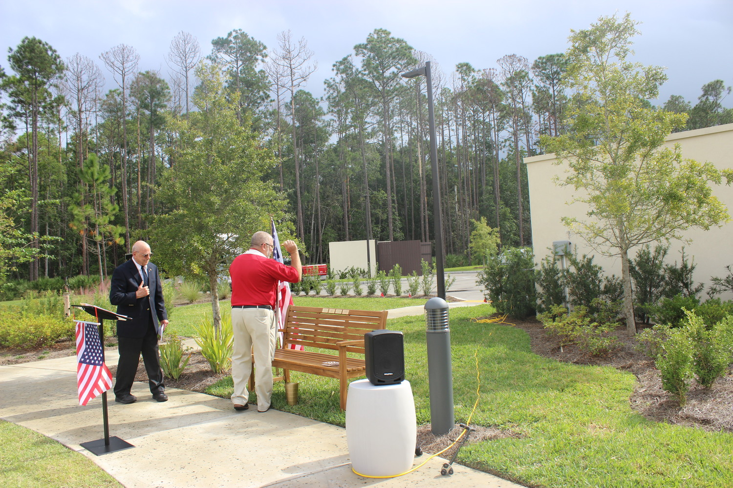 Rev. W.O. Hesse, Sr., (right) and Starling resident John Scalamandre dedicate a bench at the facility's new Reflection Garden.