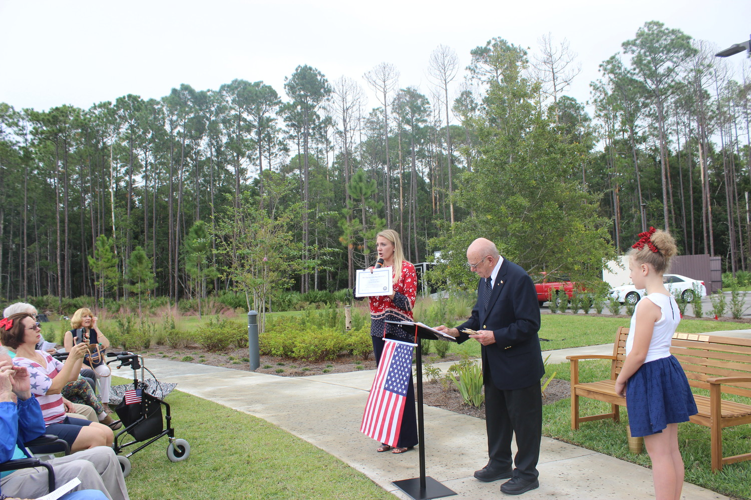 Starling at Nocatee Executive Director Megan Kennedy (left) addresses attendees of the facility's Veterans Day event on Nov. 12 and discusses certificates and pins that were presented to veterans and spouses.