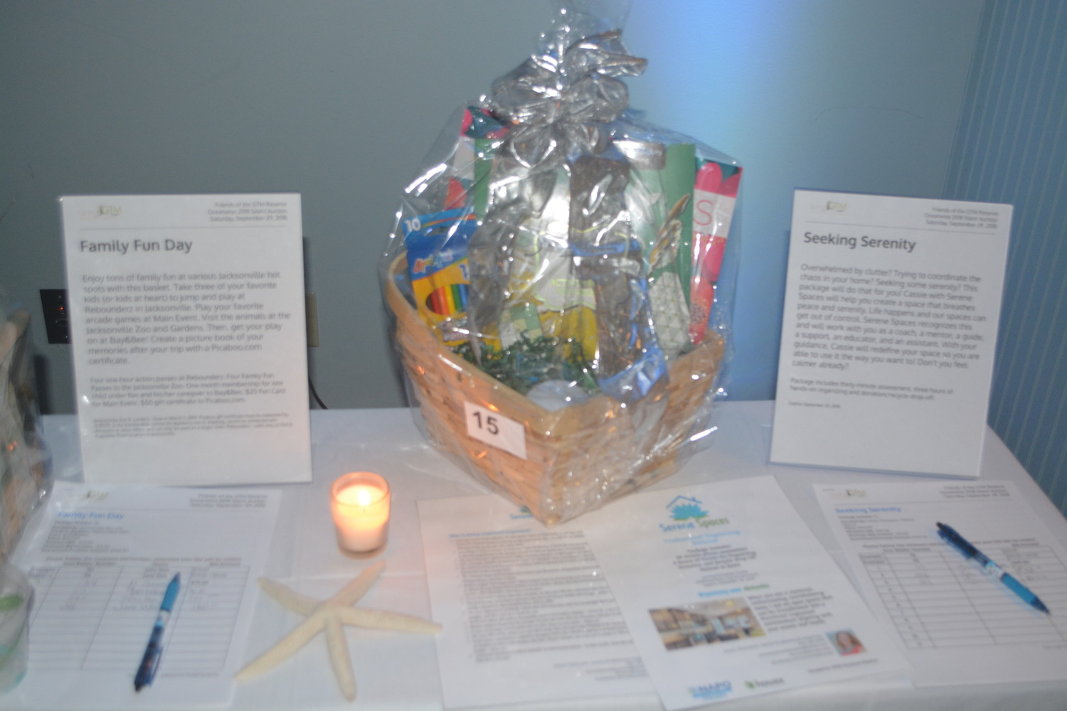 Silent auction items on display at the GTM Reserch Reserve Oceanwise gala