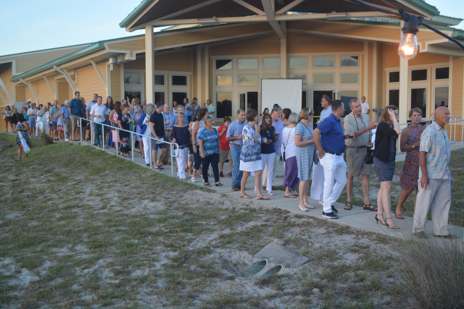 Attendees form a line as they move to the outdoor portion of the Oceanwise gala.