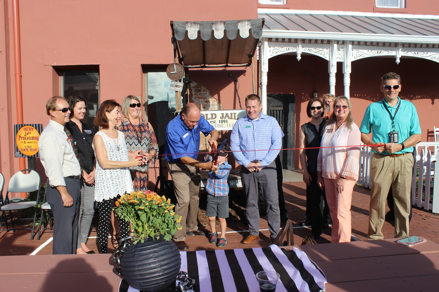 Local officials and representatives from Historic Tours of America celebrate the restoration of the Old Jail Museum in St. Augustine on Sept. 26.