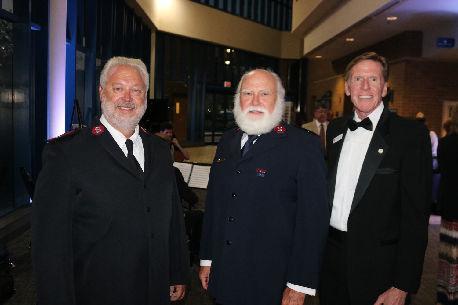 Major Tim Williford, Major Bert Tanner and Robert Devers of the Salvation Army