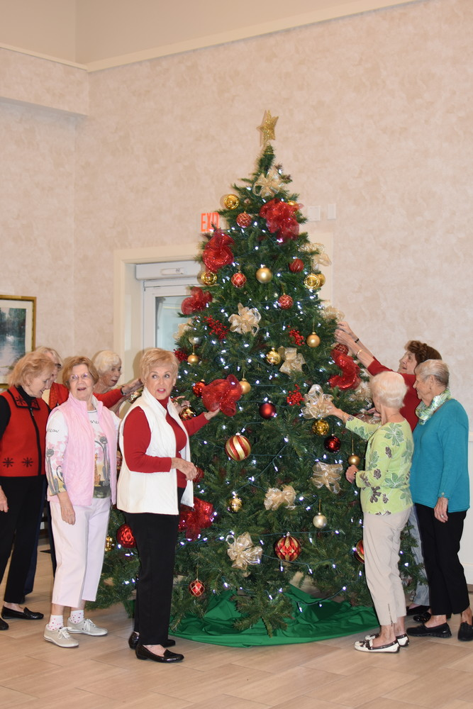 "The ""Christmas Elves"" decorate one of the trees at Vicar's Landing."