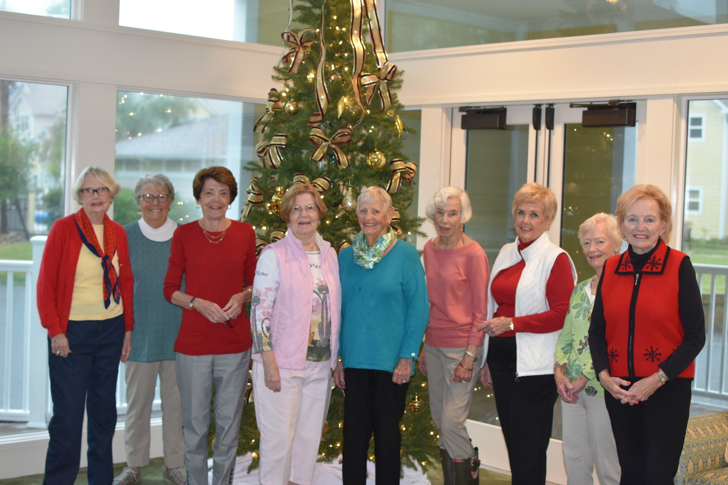 "Vicar's Landing residents Nella Gatewood, Shirley Patterson, Dottie Hood, Mary Lou Ducey, Beth Bockmeyer, Jennie Veal, Larry Leek, Mary Ann Stone and Andree Fuller gather while decorating the community for the holiday season. The women calls themselves the ""Christmas Elves."""