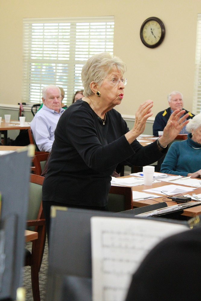 Constance Quinlan directs the Sawgrass Singers at THE PLAYERS Community Senior Center on Dec. 4.