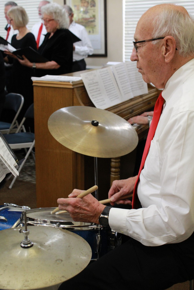 Ted Burfeind plays the drums for the Sawgrass Singers.