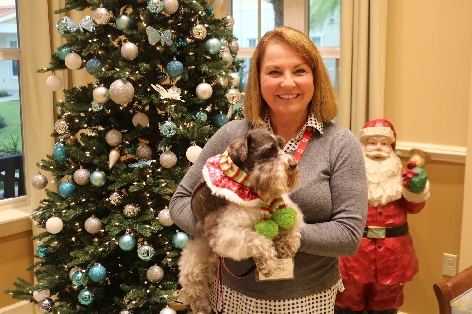 Margaret Gallardo, a volunteer pet therapy handler from Alliance of Therapy Dogs (ATD), poses for a photo with Coco.