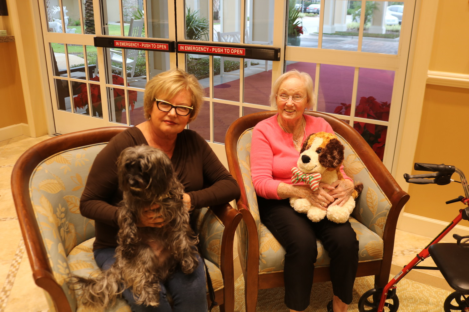 Jane Weden (left) poses for a photo with her mother, Marilyn McGuckin, and their dog Quirky at the Palms at Ponte Vedra.