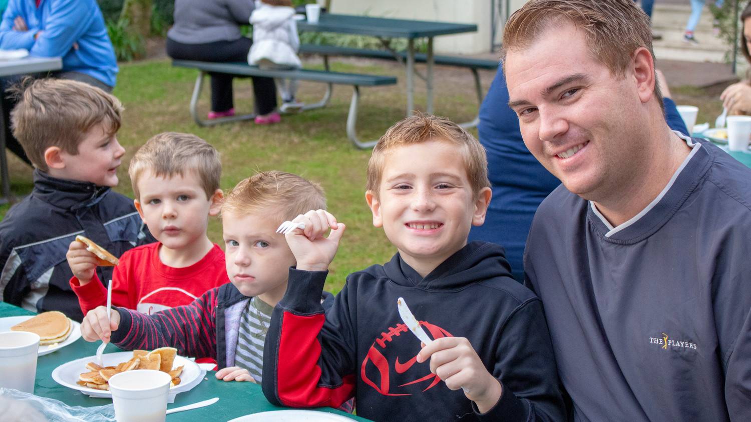 A Nocatee family enjoys breakfast at the event.