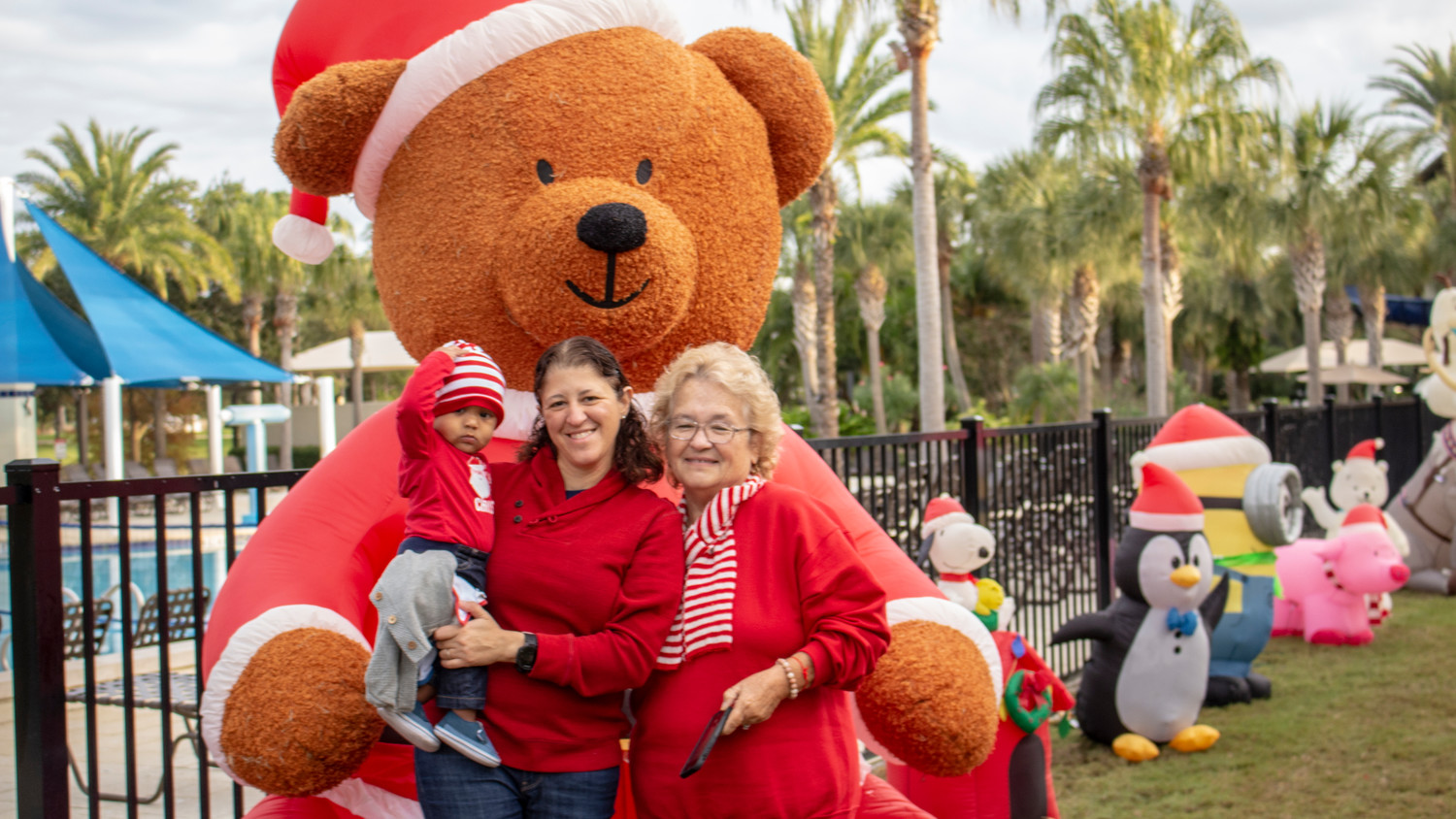 A Nocatee family stands in front of an inflatable at the Breakfast with Santa event.