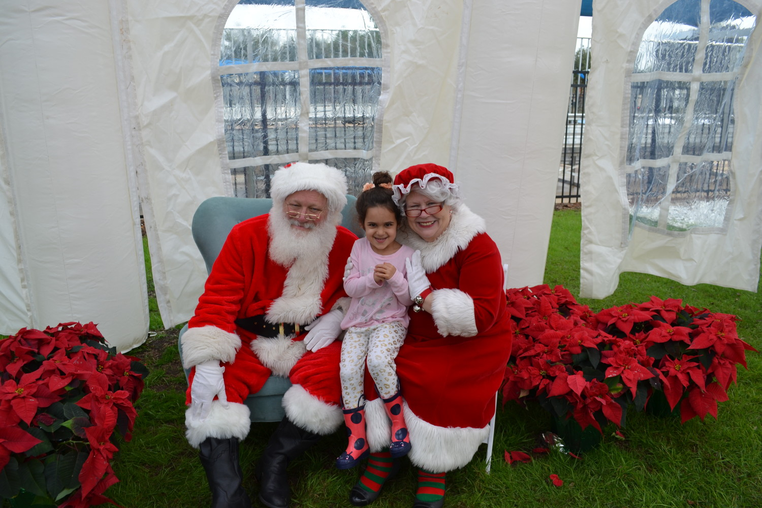 A happy girl enjoys her visit with Santa and Mrs. Claus at the Nocatee Farmers Market on Dec. 15.