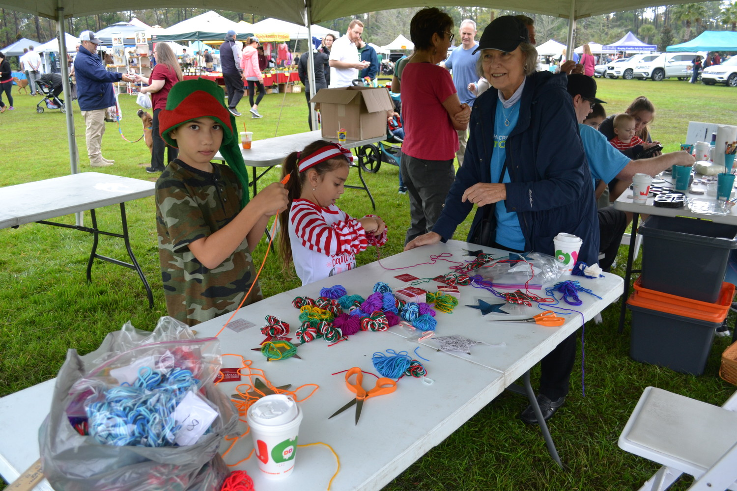 Attendees of the Farmers Market participate in arts and crafts activities.