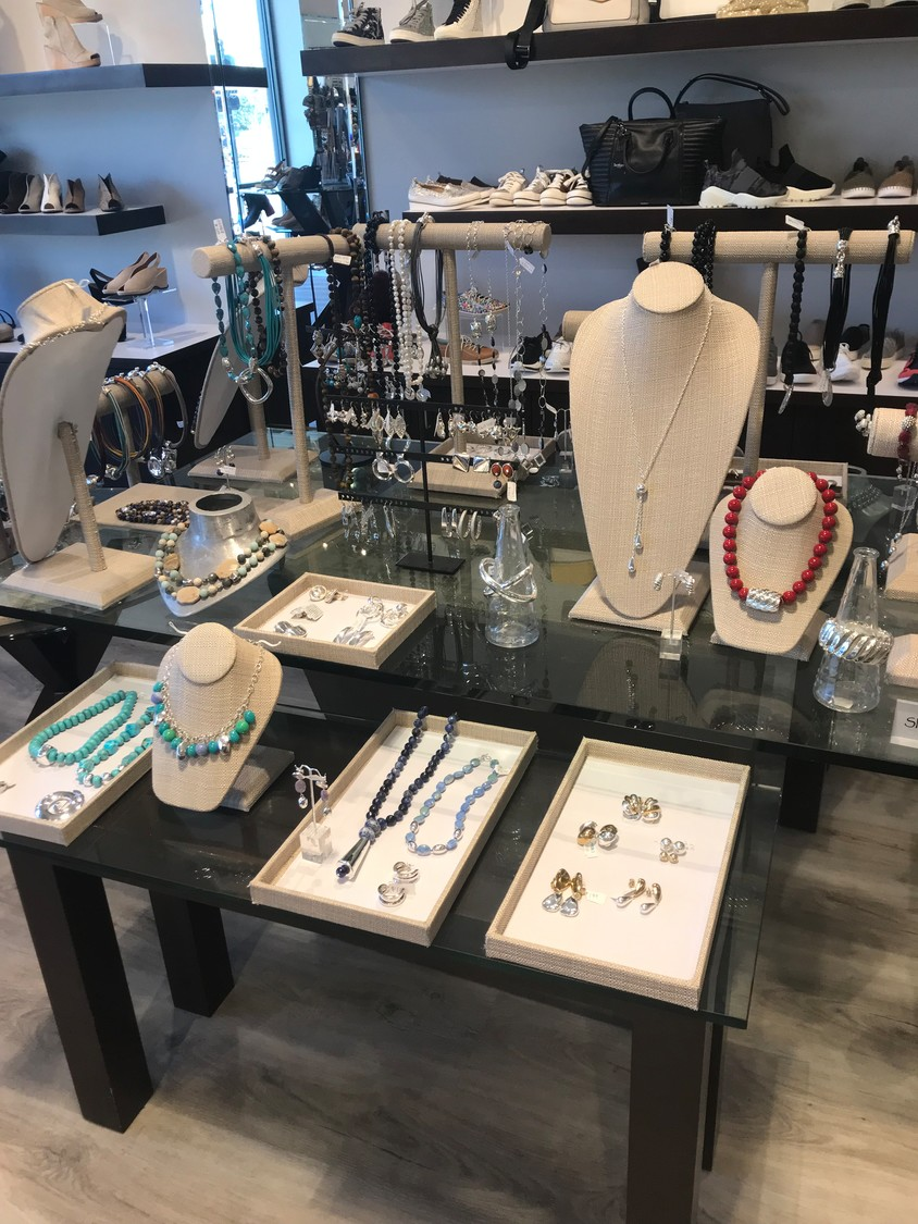 Jewelry from Simon Sebbag Designs is displayed at Carla Shoes & Accessories' trunk show on Dec. 14.