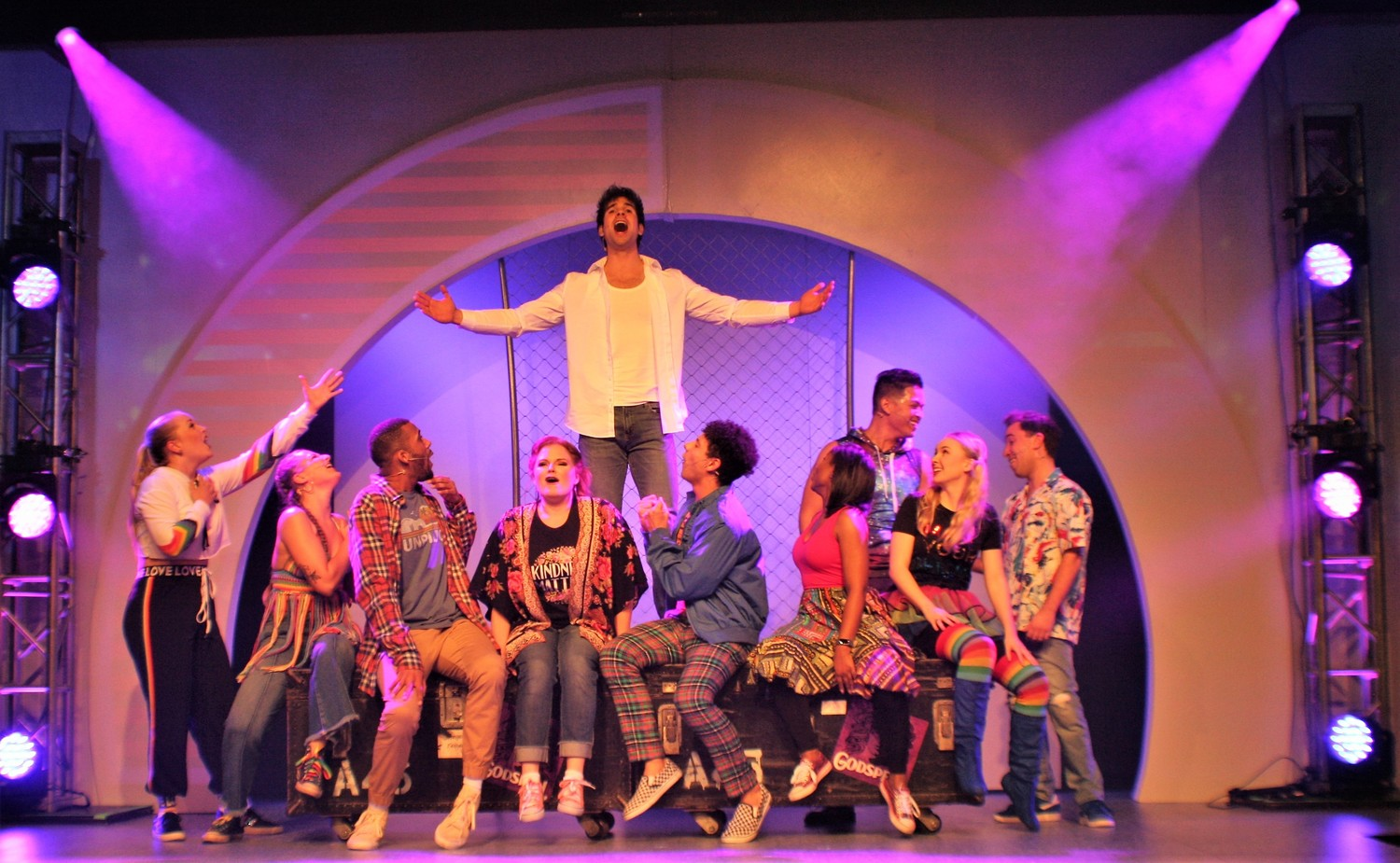 "Timothy Michael Quinn (center), who plays Jesus, sings as his disciples look on during a performance of ""Godspell"" at Alhambra Theatre and Dining."