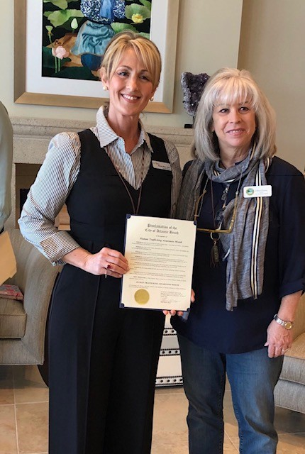 Her Song Founder and Executive Director Rachel White stands with Atlantic Beach Mayor Ellen Glasser, who presented a proclamation recognizing Her Song for its efforts in the community at a lunch and learn on Jan. 17.