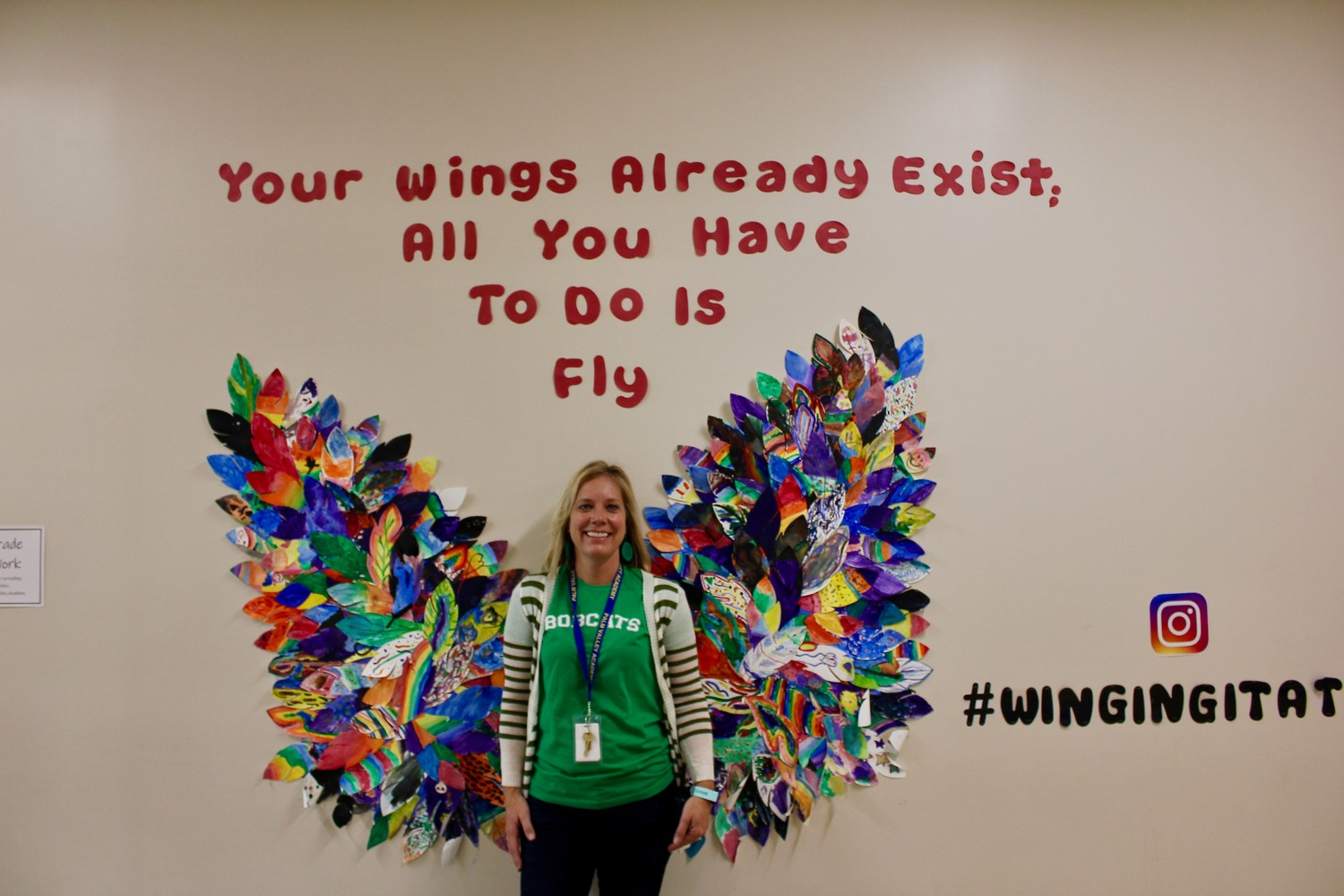 Palm Valley Academy Principal Jessica Richardson stands in front of one of the many murals that line the halls of the Nocatee school thanks to a donation from THE PLAYERS and guidance from the Ponte Vedra Public Education Foundation.