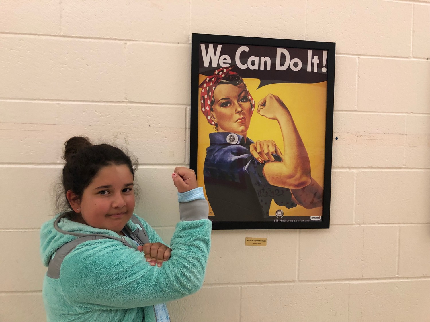 "PVPV/Rawlings student Bailee Busch stands next to ""Rosie the Riveter."""