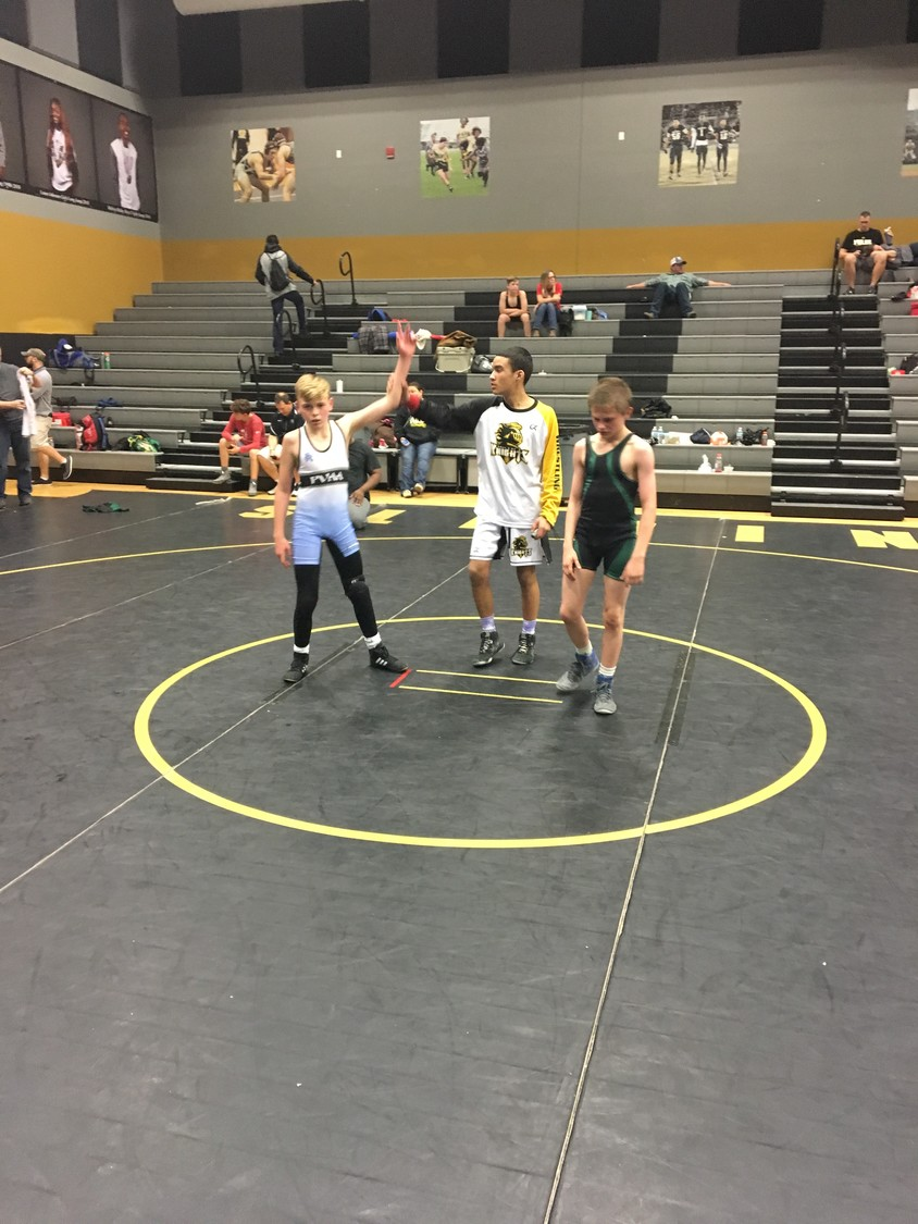 Wyatt Dize has his hand raised in victory during the Oakleaf Youth Wrestling Tournament on Jan. 27.